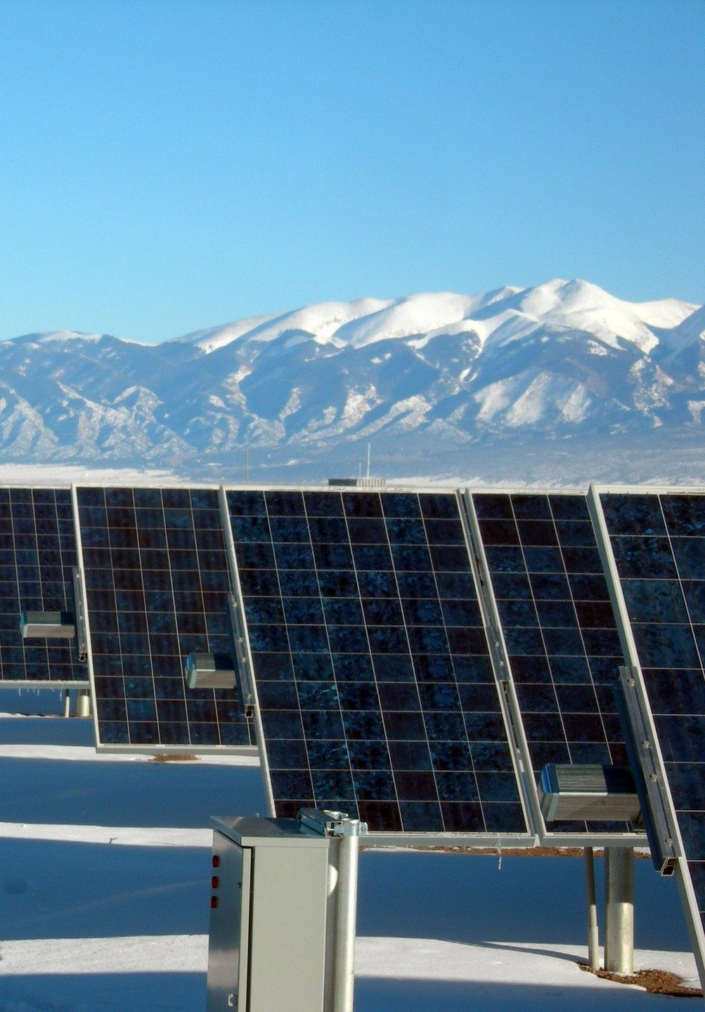 silver-and-black-solar-panels-on-snow-covered-ground-159160-2