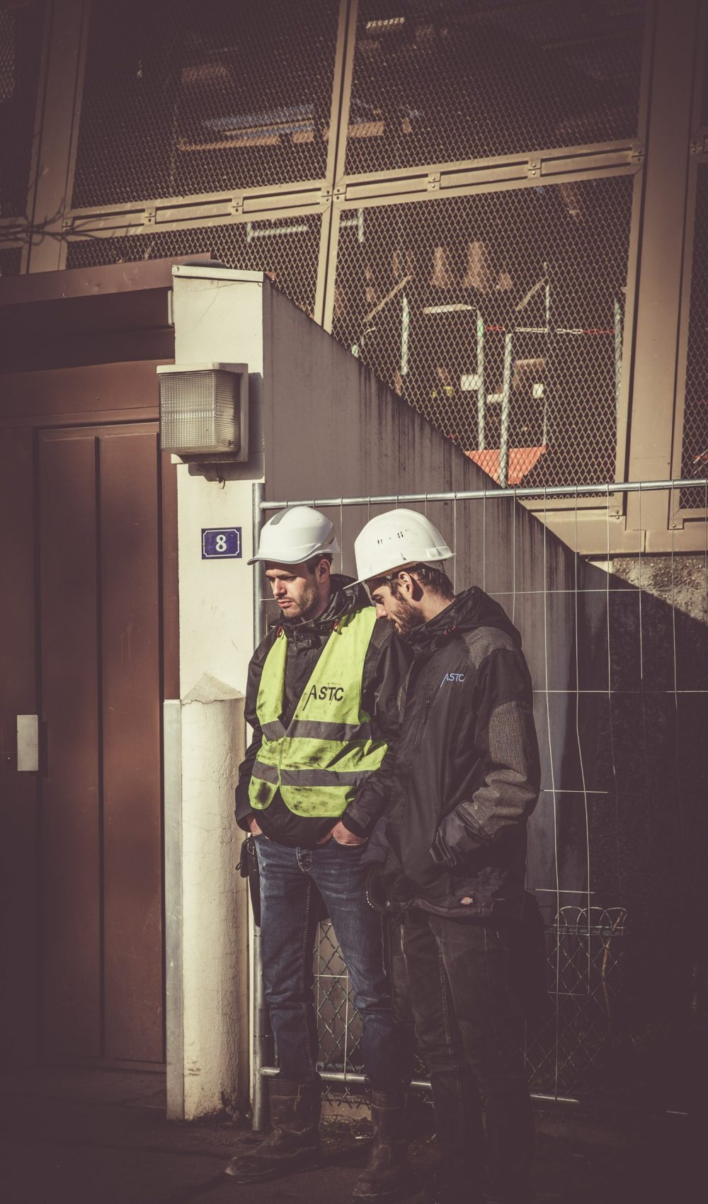 two-men-wearing-white-hard-hat-901941